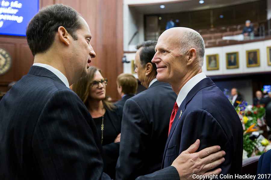 TALLAHASSEE, FLA. 3/7/17- Senate President Joe Negron, R-Stuart, talks with Gov. Rick Scott prior to the start of the Senate session during the opening day of the 2017 legislative session at the Capitol in Tallahassee.<br /> <br /> COLIN HACKLEY PHOTO