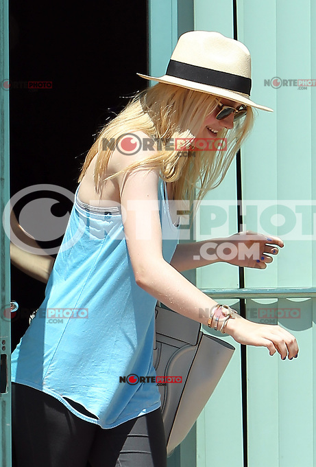 Stormy! Dakota Fanning tries to stay incognito while storming out of a dance studio in Studio City. Dakota carried a Celine bag and got surprised by the blowing wind...Credit: Correa/face to face.. /MediaPunch Inc. ***FOR USA ONLY*** ***Online Only for USA Weekly Print Magazines*** /NortePhoto.com*<br />