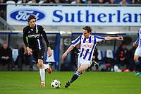 VOETBAL: HEERENVEEN: Abe Lenstra Stadion, SC Heerenveen - Vitesse, 21-01-2012, Eindstand 1-1, Mike Havenaar (#14), Sven Kums (#10), ©foto Martin de Jong