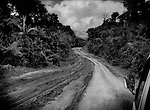 "The road from Brokopondo to Atjoni deep in the Amazon rainforest that China Dalian International is paving.  From a communique leaked by Wikileaks, the US Embassy says, ""The Chinese company Dalian (China Dalian International) is very active in road building in Suriname.  Some ministries reportedly prefer to work with the Chinese in order to receive what is perceived as complications-free cash-flow, while others worry about long-term effects (and political liabilities) of such hasty deals.  The Chinese, meanwhile, have their eyes on Surname's rich natural resources, particularly wood"".  This road roughly follows the Suriname River straight inland into the jungle, and many believe it was to be the first step to building a road to Brazil opening up the interior.  In a conversation with a Da Ware Tijd Newspaper staff writer, Eleazer Pross, a Memoranda of Understanding signed on 2 December 2010 between the government of Suriname and the Peoples Republic of China was voted down in the legislature here.  China had offered US$ 6 billion in projects to build a railroad, or road (it was never clearly stated to the public which it was) and a deep sea harbor in Paramaribo.  This would have opened up one of the world's largest untouched rainforest wildernesses to rapid encroachment along the path of the railroad/road.  Eleazer Pross said today, ?the Chinese demands were basically too much.  They basically demanded the entire (interior) forest (for logging) as compensation for building the road?.  ..."