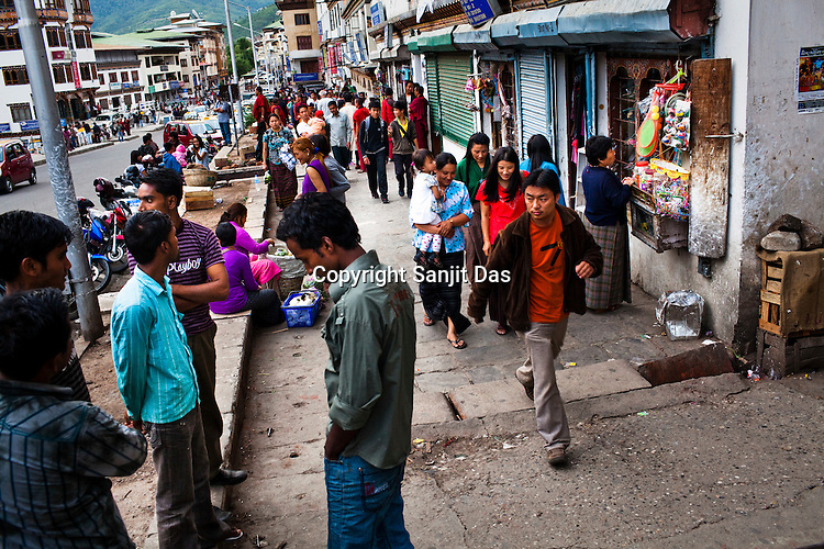 Bhutanese dressed in both traditional and western outfits seen running their daily chores at the main market in Thimphu, Bhutan. Photo: Sanjit Das/Panos