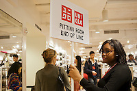 End of the line for the fitting room at the grand opening of the Uniqlo Flagship store on Fifth Avenue in New York on Friday, October 14, 2011.  The store is a staggering 89,000 square feet on multiple levels and is Fast Retailing's second store in the United States with a third opening next week in the Herald Square shopping district. The largest store on Fifth Avenue filled to the brim with affordable clothing it competes with stalwarts such as the Gap and Zara which are in the immediate proximity. Fast Retailing plans on opening 200 to 300 stores worldwide until 2020 and currently has 1000 stores. (© Richard B. Levine)