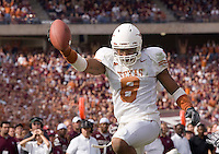 Texas Longhorn defensive back Cedric Griffin runs for a touchdown after a turnover during a 40 to 29 win over the Texas A&M Aggies on November 25, 2005 at Kyle Field in College Station, Texas.