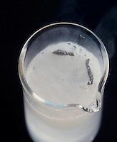 LITHIUM REACTS VIGOROUSLY WITH WATER<br />