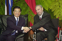 HAVANA, CUBA- NOVEMBER 22 -The president from China, Hu Jintao shakes hands with the Cuban President Fidel Castro, November 22, 2004, Jintao, arrives in Cuba after visiting Brazil, Argentina and Chile. Credit: Jorge Rey/MediaPunch