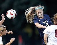 Yale University midfielder Frannie Coxe (2) heads the ball. In overtime, Harvard University defeated Yale University,1-0, at Soldiers Field Soccer Stadium, on September 29, 2012.