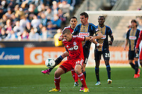 Sebastien Le Toux (11) plays the ball as Ryan Richter (33) of Toronto FC attempts to shield him. Toronto FC and the Philadelphia Union played to a 1-1 tie during a Major League Soccer (MLS) match at PPL Park in Chester, PA, on April13, 2013.