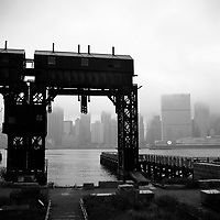 Disused gantries and docks in Long Island City. Manhattan is on the opposite shore. The docks of New York and New Jersey have for generations been synonymous with organised crime, with the Genovese family in control of the New Jersey waterfront and the Gambinos in control of the New York side.