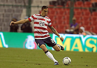 MEXICO CITY, MEXICO - AUGUST 15, 2012:  Geoff Cameron (20) of the USA MNT kicks the ball up field against Mexico during an international friendly match at Azteca Stadium, in Mexico City, Mexico on August 15. USA won 1-0.