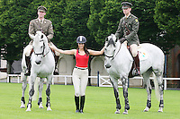 22/7/2010. Model Georgia Salpa is pictured with Capt David Power and Capt David O Brien members of the army Equitation School with River Foyle and Lough Foyle at the RDS for the launch of the 2010 Fáilte Ireland Dublin Horse Show. Picture James Horan/Collins Photos