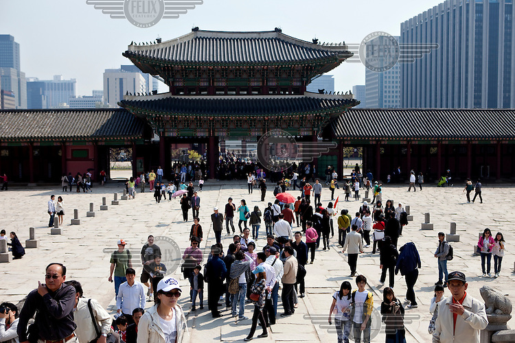 Crowds throng the entrance to the Gwanghwamun of Gyeongbokgung Palace, the main royal palace of Joseon Dynasty.