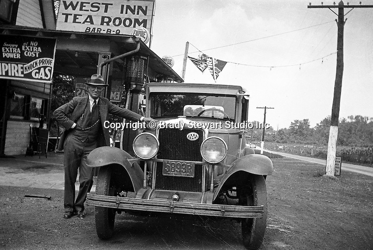 Western PA:  Brady Stewart standing next to his 1929 Chevy Coach after having lunch at the West Inn Tea Room - 1931