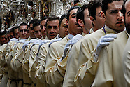 The silver-coated throne is carried on the shoulders of the carriers during the Easter celebration in Malaga, Spain, 2 April 2007.