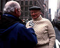 Former New York City Mayor Edward I. Koch gives an interview to veteran WCBS radio reporter Rich Lamb during the St. Patrick's Day Parade on March 17, 2001. The parade is the largest St. Patrick's Parade in the United States with 150,000 marchers. (© Richard B. Levine)