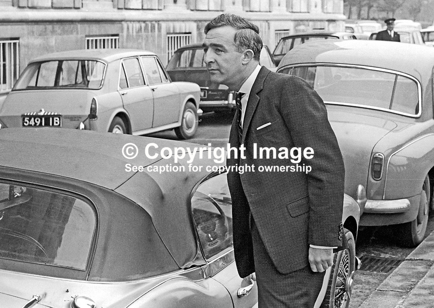 Desmond Boal, MP, Ulster Unionist, parks his sports car on arrival at Parliament Buildings, Stormont, Belfast, N Ireland, UK, September 1966. 196602000044a<br />
