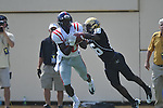 Vanderbilt defensive back Eddie Foster (16) deflects the ball away from Ole Miss' Vince Sanders (10) in Nashville, Tenn. on Saturday, September 17, 2011. Vanderbilt won 30-7..