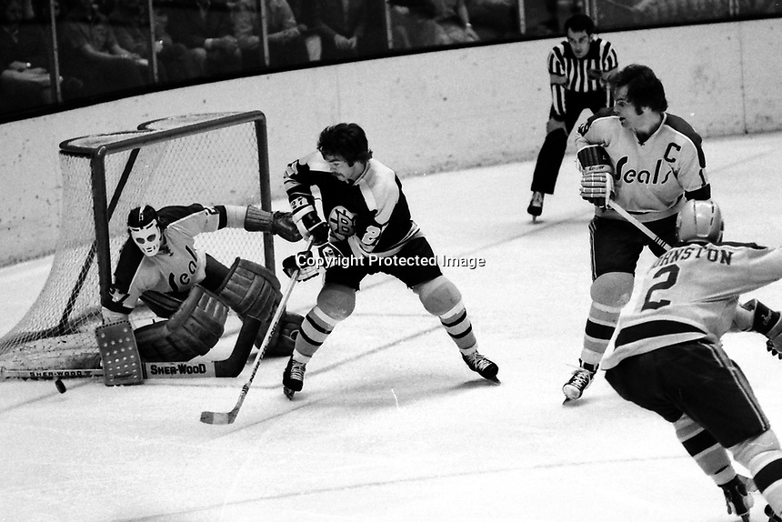 Boston Bruins Doug Gibson shot on Seals goalie Giles Meloche. (photo 1973 by Ron Riesterer)