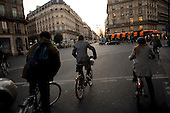 Paris, France.November 16, 2007..Commuters struggling with public transportation take to riding bicycles (often the new public Velib bicycles) at rush hour along side cars, trucks, motorcycles and scouters. The French public transport unions (SNCF, RATP) remained on strike for the third day in a major test for President Nicolas Sarkozy's reforms. They are protesting against the scrapping of pension privileges that allow some public employees to retire as early as age 50...
