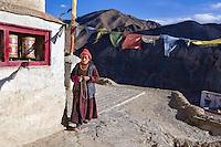 Ladakhi woman repeating buddhist 'mantra'   while doing 'parikrama'  (circular walk around religious place). Lamayuru monastery, Ladakh, Jammu and kashmir, India.