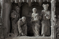 Jesus writing in the sand while the accusers of the adulterous woman leave, after Jesus proclaims 'let he who is without sin cast the first stone'. The Adulterous Woman, by Jean de Dieu of Arles, 1679-81, from the choir screen, Chartres Cathedral, Eure-et-Loir, France. Chartres cathedral was built 1194-1250 and is a fine example of Gothic architecture. It was declared a UNESCO World Heritage Site in 1979. Picture by Manuel Cohen.
