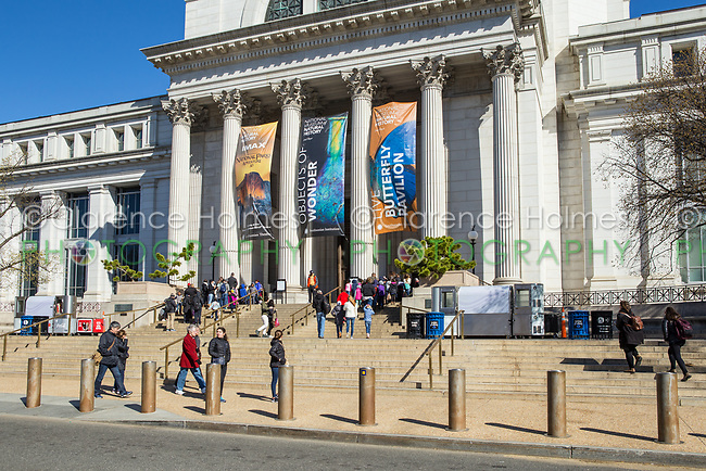 Tourists and visitors enter the Neo-classical National Museum of Natural History on the National Mall in Washington, DC.