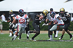 Vanderbilt quarterback Larry Smith (10) is chased by Ole Miss' Mike Marry (52) and Ole Miss' Gerald Rivers (90) in Nashville, Tenn. on Saturday, September 17, 2011. Vanderbilt won 30-7..