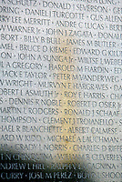 Jun 14, 2004; Washington DC, Washington, USA;  Washington Monument reflection off the stone of the Vietnam Veterans War Memorial inside Constituion Gardens. Names are in focus. Landmark travel location.