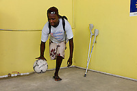 Port Au Prince, Haiti, April 19, 2010.Pierre Mackenson, 27 lost his right leg when his house collapsed, he loves sports and is already playing basket-ball and some football. Handicap International center; thousands of people have lost one or more limbs in the January 12 earthquake; the need for prosthetics and reeducation is enormous and will be long lasting as many victims are children who will need constant adjustments to their prothesis.