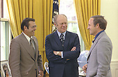 United States President Gerald R. Ford chats with Chief of Staff Donald Rumsfeld and Rumsfeld&rsquo;s assistant Richard Cheney in the Oval Office of the White House in Washington, DC on April 28, 1975.<br /> Mandatory Credit: David Hume Kennerly / White House via CNP