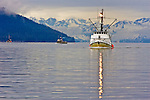 "The salmon tender ""Polar Star"" cruises Prince William Sound's Port Wells, while buying salmon from smaller fishing vessels to deliver to the cannery in Cordova, Alaska."