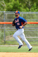 New York Mets left fielder Tim Tebow (15) jogs to the dugout in between innings during an Instructional League game against the Miami Marlins on September 29, 2016 at the Port St. Lucie Training Complex in Port St. Lucie, Florida.  (Mike Janes/Four Seam Images)