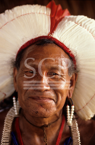 A-ukre village, Brazil. Xingu, Para state, Cacique Mote Kayapo, a village chief, with white feather coca crown.