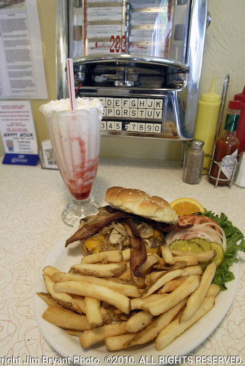 Bacon, fried onions, cheeseburger, french fries and strawberry milkshake.  Jim Bryant Photo. ©2010. All Rights Reserved.