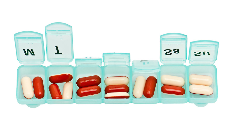 Image of pill organizer with medicine inside.