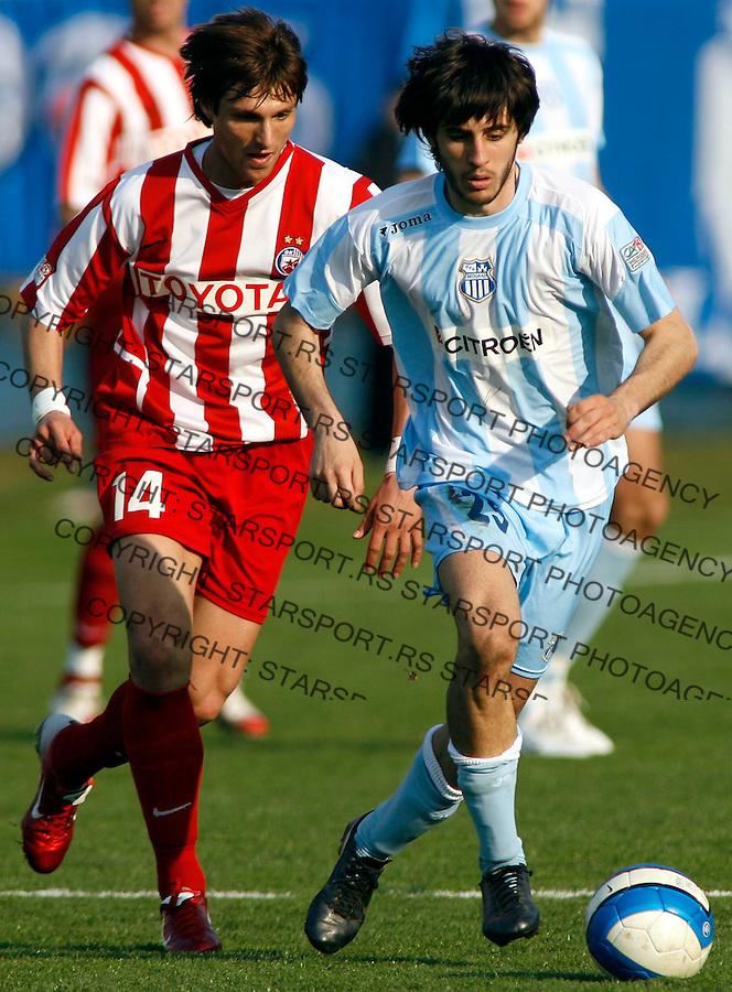 Fudbal, Super league, season 2006/07<br /> OFK Beograd Vs. Crvena ZVezda<br /> Stefan Babovic, right and Aleksandar Trisovic, left<br /> Beograd, 17.03.2007.<br /> foto: Srdjan Stevanovic
