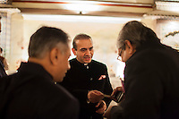 Nirav Modi (center) passes his business card to an unidentified guest at the OzFest Gala Dinner in the Jaipur City Palace, in Rajasthan, India on 10 January 2013. Photo by Suzanne Lee