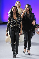 Artists and fashion designers Susan Pizarro-Ekert and Pietra Banchi, walk runway with models at the close of the Pietra Pizzaro Fall 2012 The Future Feminine collection, during Couture Fashion Week New York, February 17, 2012.