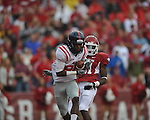 Ole Miss' Ja-Mes Logan catches a touchdown pass in front of Arkansas cornerback Darius Winston (21) at Reynolds Razorback Stadium in Fayetteville, Ark. on Saturday, October 23, 2010.