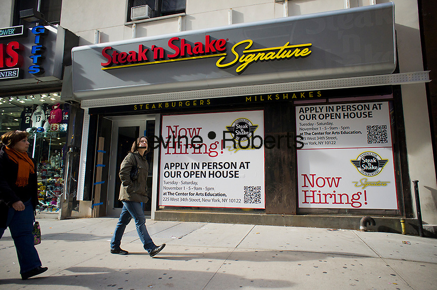A sign outside the unfinished Steak 'n Shake Signature restaurant in New York advertises that they are hiring employees, seen on Sunday, November 27, 2011. The Midwestern based burger chain is opening its first restaurant in New York, near Times Square. (© Richard B. Levine)