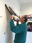 "Huntington, New York USA. March 27, 2017. After end of ""Her Story Through Art"" Invitational Exhibition celebrating Women's History Month, artwork is taken down at Main Street Gallery at Huntington Arts Council. Bob Stuhmer helps remove photographs by Ann Parry."