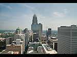 The skyline of Charlotte NC from atop on of the buildings. This view is looking north up Tryon St.