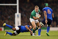 Ian Madigan of Ireland takes on the France defence. Rugby World Cup Pool D match between France and Ireland on October 11, 2015 at the Millennium Stadium in Cardiff, Wales. Photo by: Patrick Khachfe / Onside Images