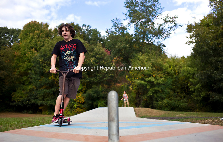 Plymouth, CT- 08 October 2015-100815CM04-  <br /> Frankie Buckley, 15 of Terryville takes a spin on a scooter at the The Plymouth Skate Park on Thursday.  The Plymouth Skate Park committee held an appreciation ceremony to recognize the individuals, organizations and foundations who helped build the park.     Christopher Massa Republican-American