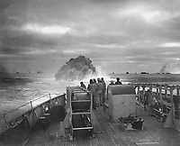 Coast Guardsmen on the deck of the U.S. Coast Guard Cutter Spencer watch the explosion of a depth charge which blasted a Nazi U-boat's hope of breaking into the center of a large convoy.  Sinking of U-175, April 17, 1943.  WO Jack January.  (Coast Guard)<br /> NARA FILE #:  026-G-1517<br /> WAR &amp; CONFLICT BOOK #:  970