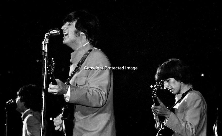 The Beatles preform at the Cow Palace in San Francisco. Paul McCartney, John Lennon and George Harrison on stage. (Aug 31,1965 photo by Ron Riesterer)