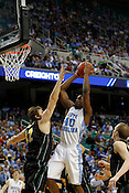 Harrison Barnes makes a layup for 2 of his 14 total points. UNC defeated Vermont 77-58 during the 2nd round of the 2012 NCAA Basketball Championship at the Greensboro Coliseum in Greensboro, NC. Photo by Al Drago.