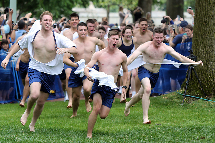 "UNITED STATES - MAY 23 - Freshman midshipmen, known as ""plebes,"" run to climb the Herndon Monument, a finale to their first year at the U.S. Naval Academy, in Annapolis, Md., Monday, May 23, 2016. Plebes are tasked with working together to summit the 21 foot monument, which is covered with 50 pounds of vegetable shortening, and replacing the dixie cap on the top with a midshipman cover. Midshipman 4th Class Chris Bianchi, swapped hats after 1 hour 12 minutes 30 seconds. (Photo By Al Drago/CQ Roll Call)"