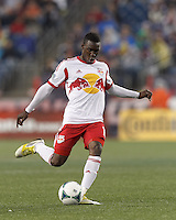 New York Red Bulls midfielder Lloyd Sam (10) takes a free kick. In a Major League Soccer (MLS) match, the New England Revolution (blue) tied New York Red Bulls (white), 1-1, at Gillette Stadium on May 11, 2013.