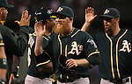 Oakland Athletics  closer Sean Doolittle high-five teammates after holding off the  Seattle Mariners in the 11th inning September 13, 2014 at Safeco Field in Seattle. The Athletics beat the Mariners 3-2 when  Mariners pitcher Fernando Rodney  walked in Coco Crisp in the 10th inning. The game went 11 innings. ©2014. Jim Bryant Photo. All Rights Reserved.