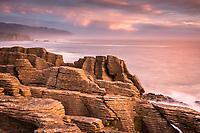 Pancake Rocks, limestone formations in Punakaiki at pastel sunset, Paparoa National Park, Buller Region, West Coast, New Zealand, NZ